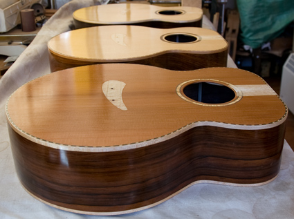 Three guitars ready for final polish