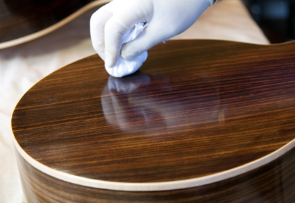 French polishing guitar back